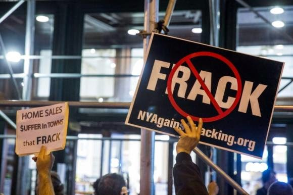 Protesters demonstrate against fracking, as New York State Governor Andrew Cuomo takes part in a book signing promoting his new book, ''All Things Possible'', in New York October 15, 2014. (Credit: Reuters/Lucas Jackson) Click to Enlarge.
