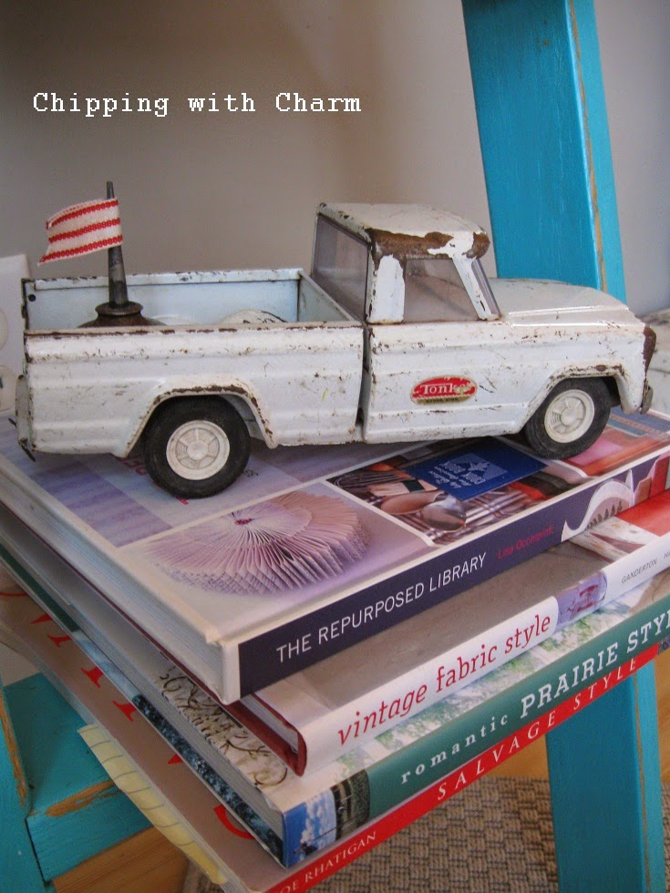 Chipping with Charm:  Aqua Ladder Book Shelf...http://www.chippingwithcharm.blogspot.com/