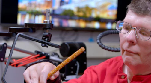 New technology allows tetraplegic man to move hand with thought