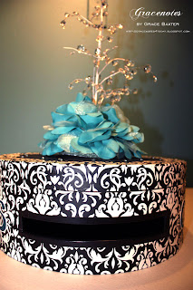 Wedding Card Box; black and white with teal-aqua embellishment and a fountain of crystals. Designed by Grace Baxter.