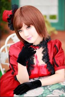 Koyuki cosplay as Vocaloid Meiko