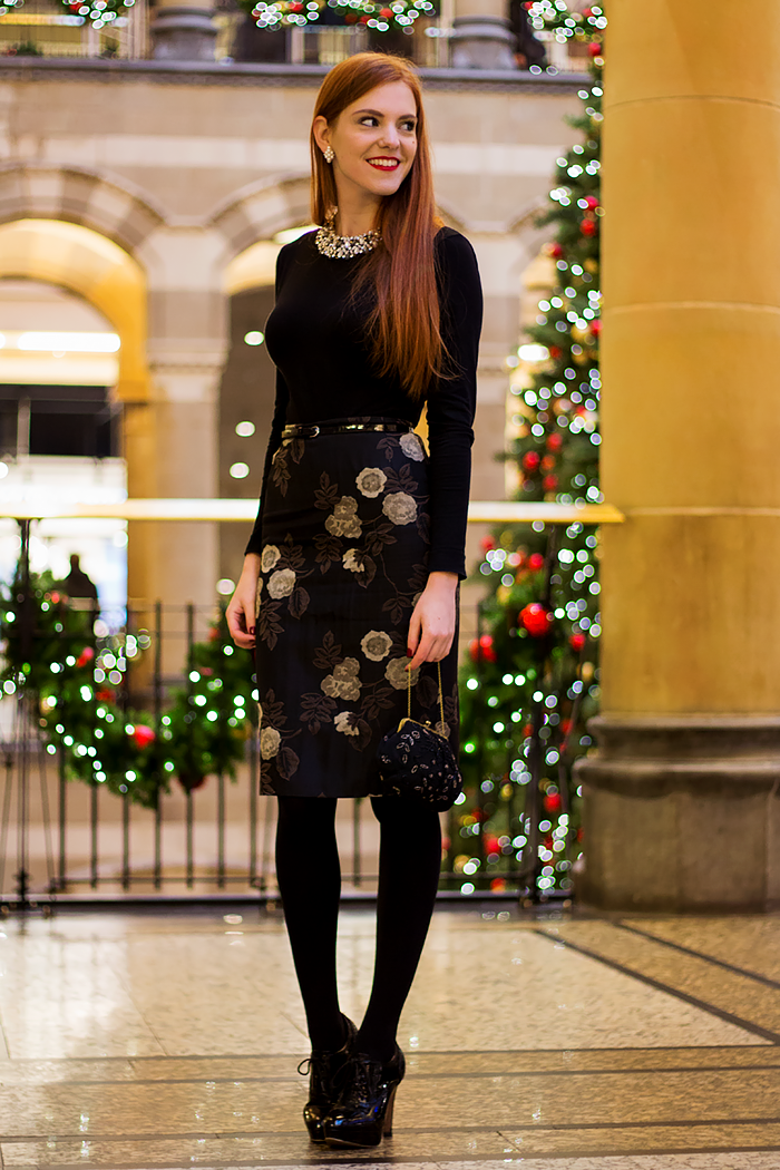 Fashion Blogger Christmas Outfit with a black and gold midi skirt and statement necklace