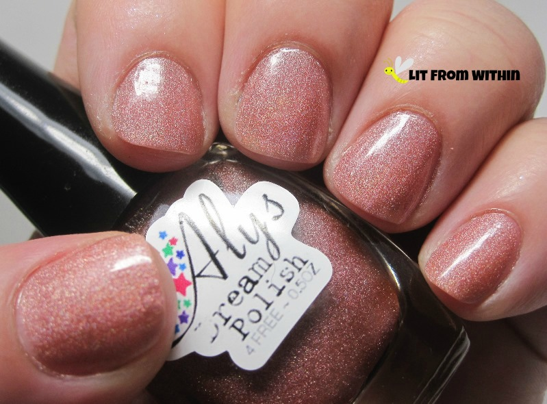 Aly's Dream Polish Melon, a pretty, feminine peachy-pink scattered holo