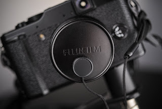 Fujifilm X10 with lens keeper. Useful cheap accessory.