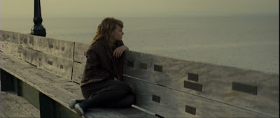 Carey Mulligan reflecting on a jetty in Never Let Me Go (film)