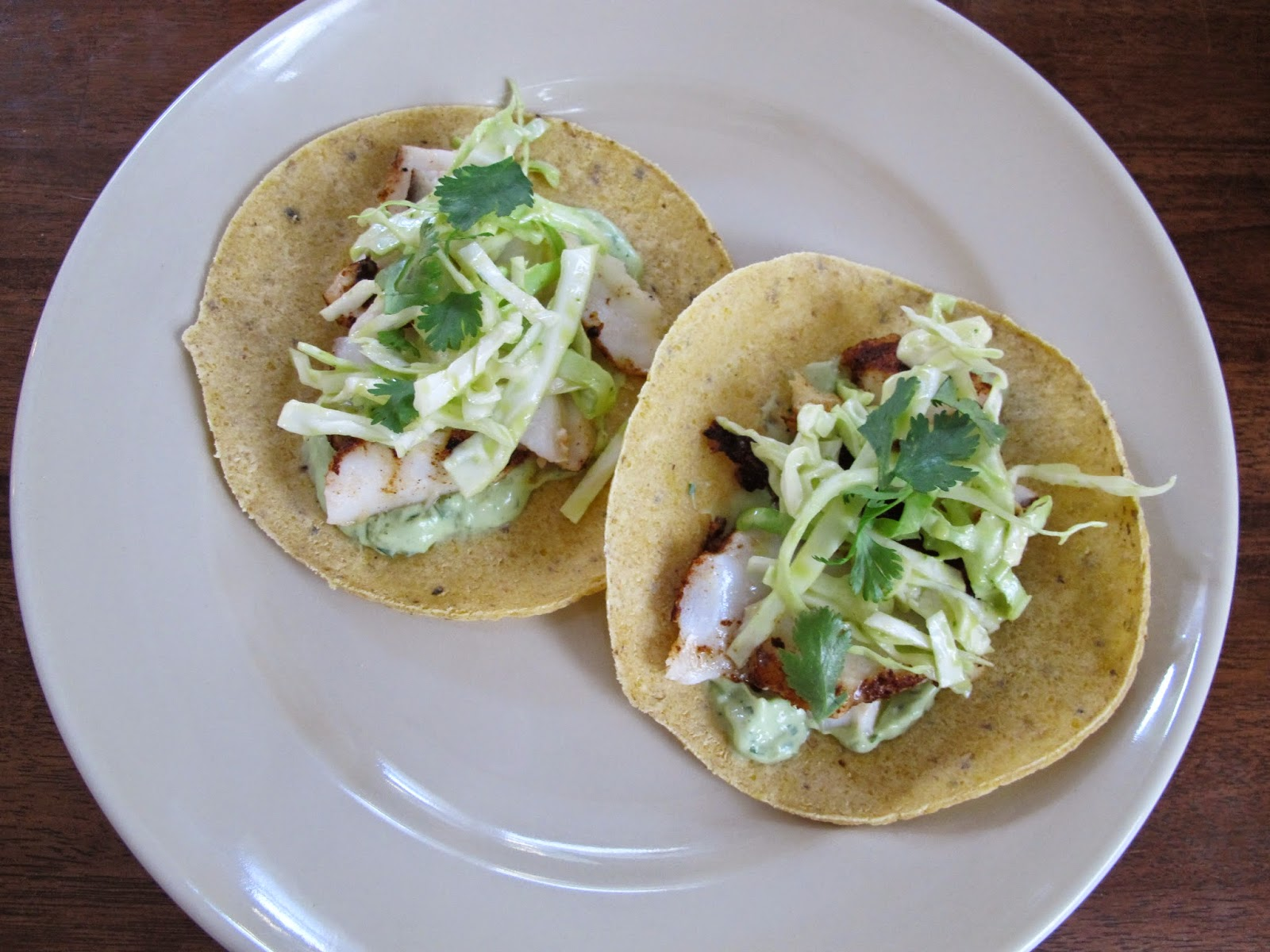Fish Tacos with Avocado Crema and Citrus Cabbage Slaw