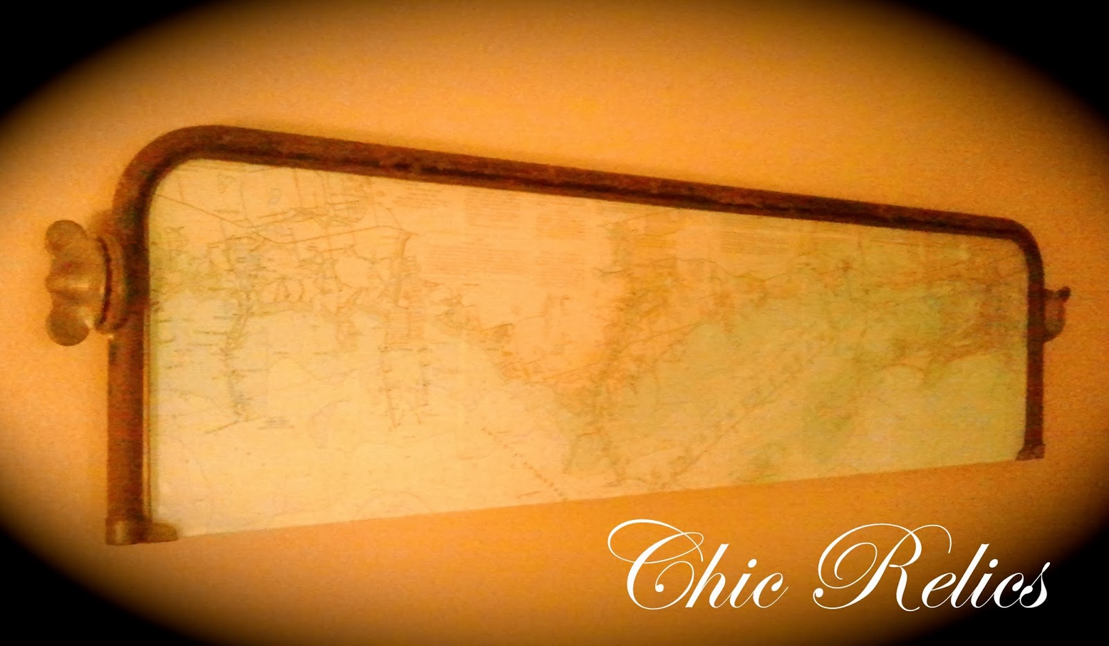 antique model t windshield with nautical map wall art