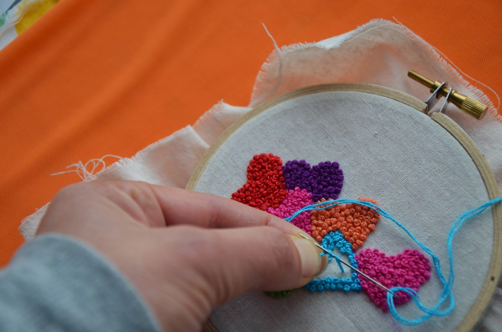 Steps 3 & 4: Wrap your thread around your needle twice with a firm grip
