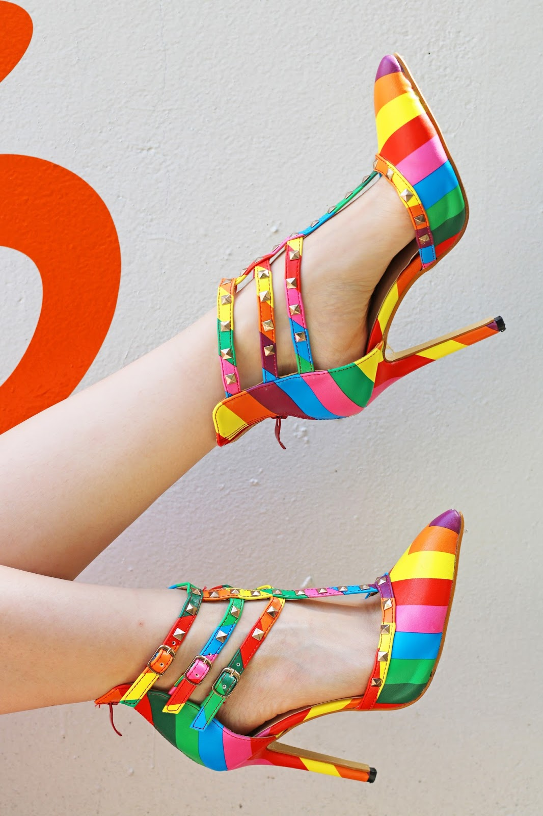 Loving these bright and bold rainbow heels!