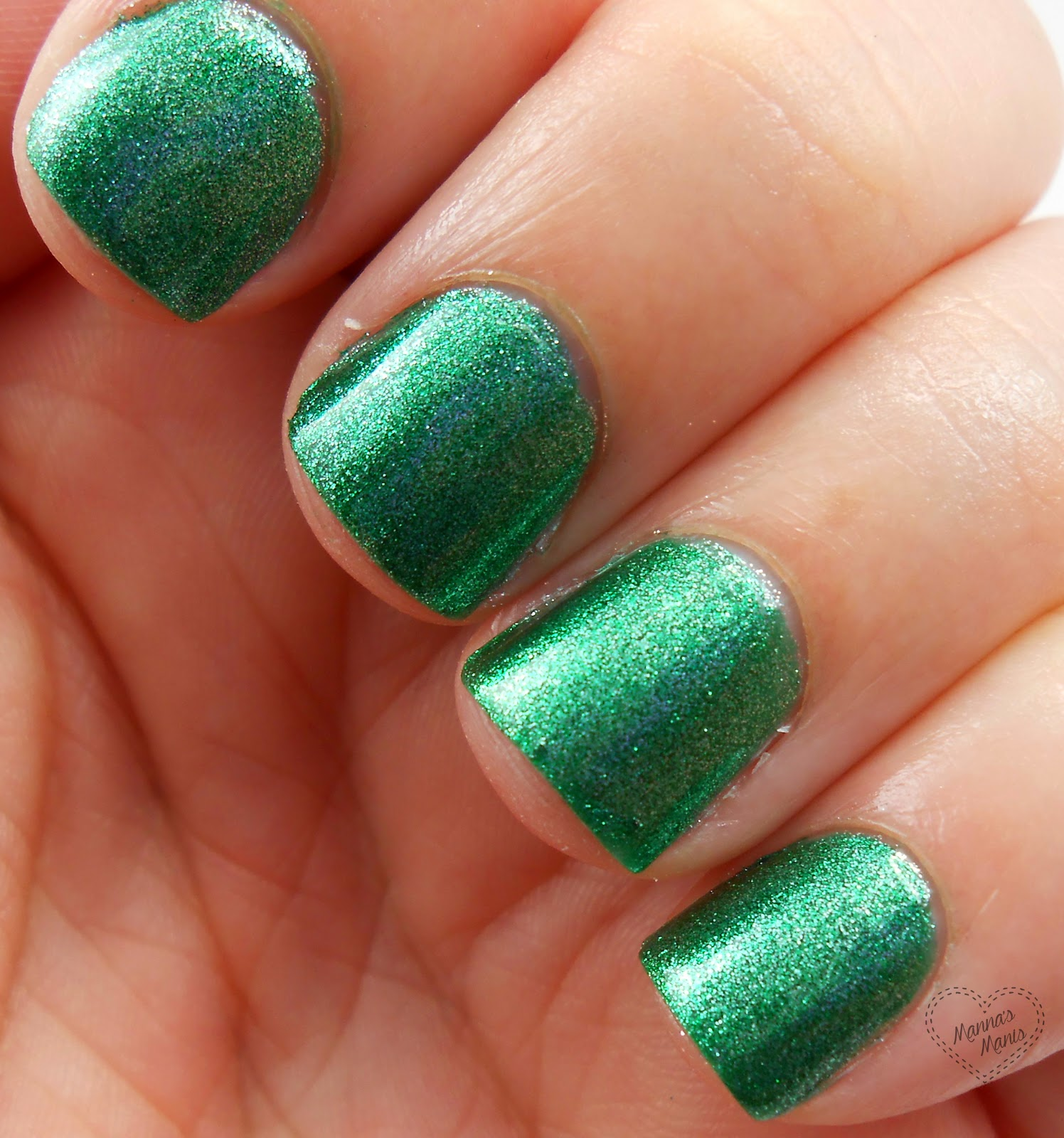 sinful colors pine away, a green shimmer nail polish