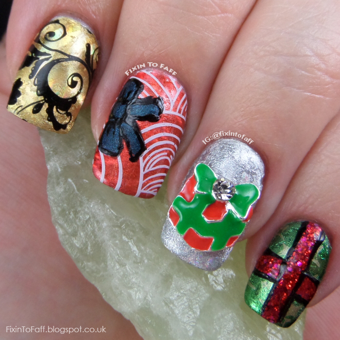 Christmas presents nail art featuring nail foils, stamping, freehand painting, and a nail charm.