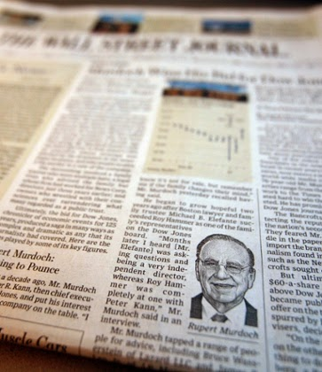 A photograph of the front page of the edition of the Wall Street Journal reporting on Rupert Murdoch's News Corp purchase of Dow Jones & Co.  (Credit: Mike Segar/Reuters)  Click to enlarge.