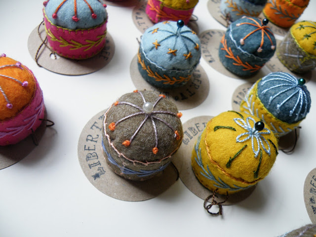 hand embroidered felt pincushions made from wine screw caps, wadding and felt