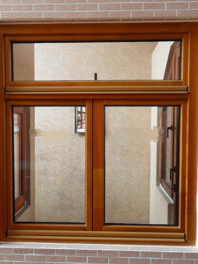 Evens construction pvt ltd door and window frames for Wood window door design