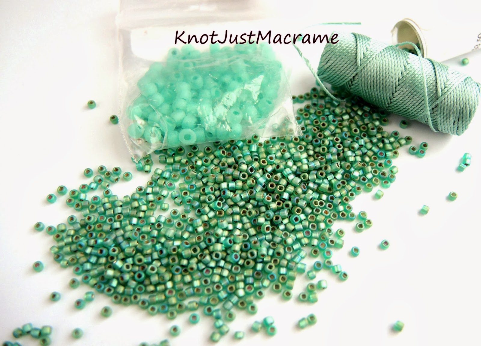 Turquoise colored glass seed beads and cord