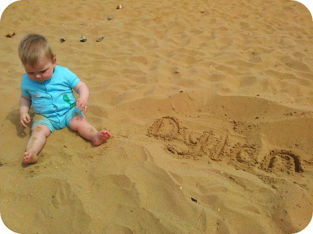 baby at the beach, writing in the sand, Dylan