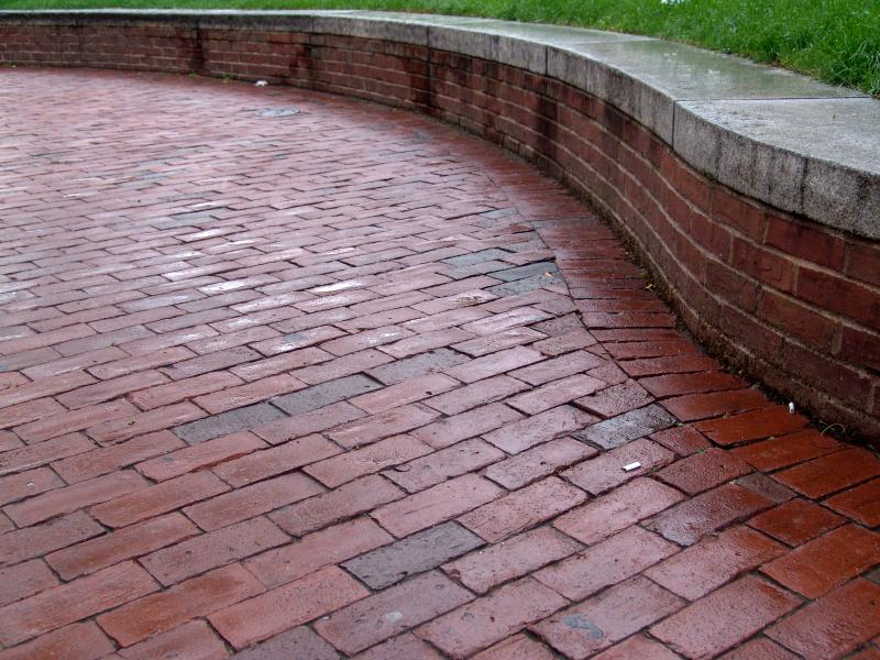 Brick patio brick phone picture for Brick wall patio designs