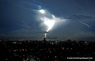 Lightning hits a building and lights up the sky over Jakarta, Indonesia.