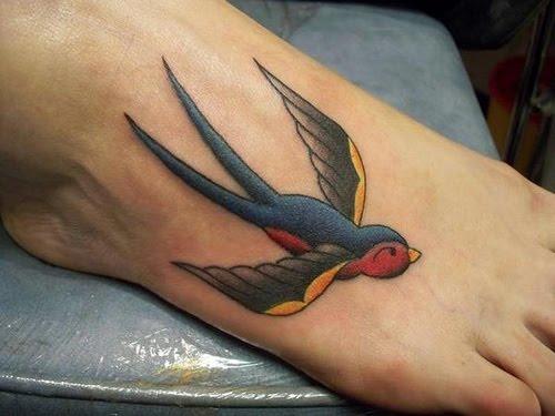 Swallow tattoo on foot info for Swallow art tattoo