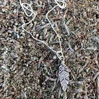 fine silver feather pendant by Emeline Purcell