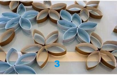 Simple creative wall decoration idea from waste paper for Decoration from waste things