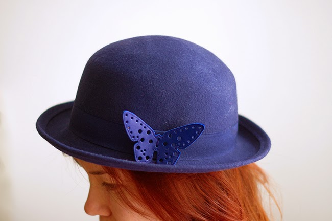 Decorate your hat with a handcrafted leather butterfly. Easy fashion tutorial created by Xenia Kuhn for www.fashionrolla.com