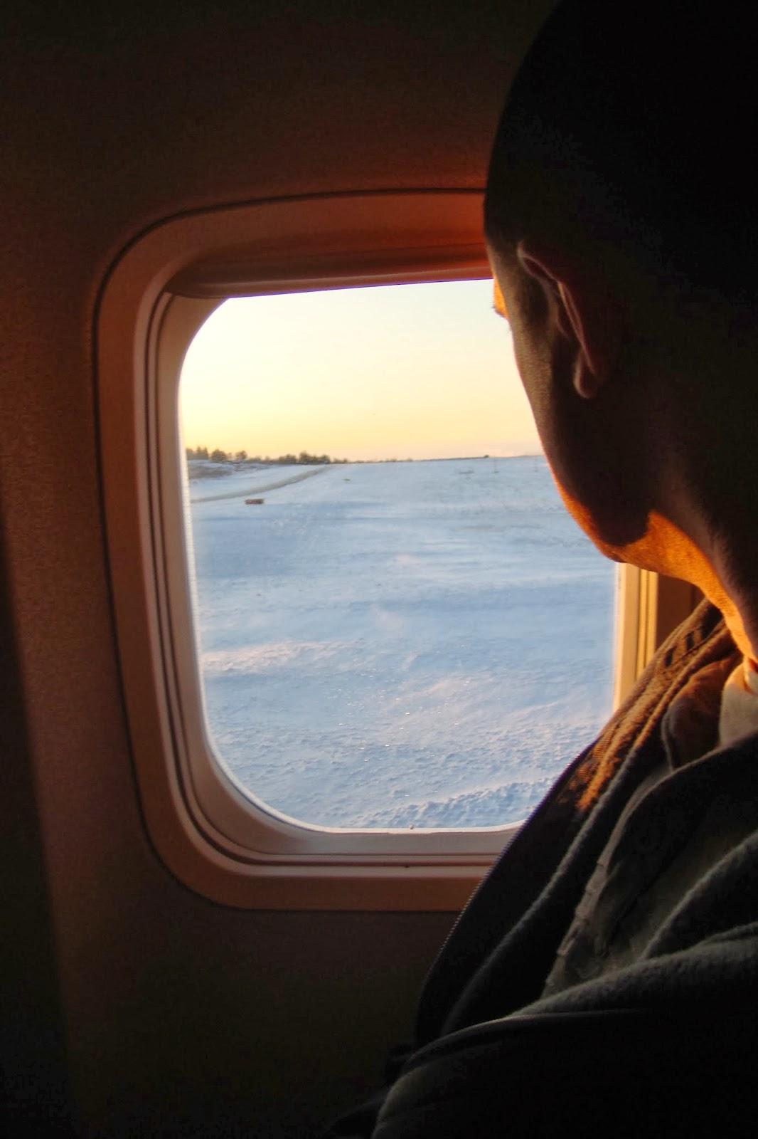 plane window and snow