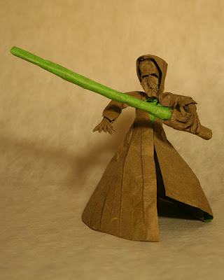 origami jedi with green lightsaber