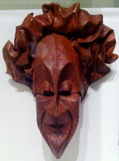 Harlequin Mask that looks to be hard wood but is Origami.