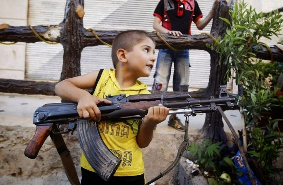 Child with his AK-47 Riffle