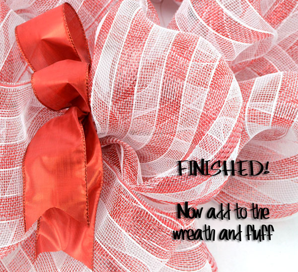 Add ribbon tuck to your wreath