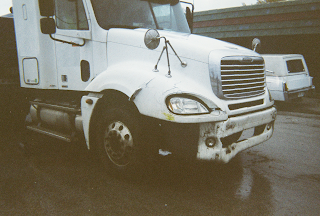 Semi with damage from accident