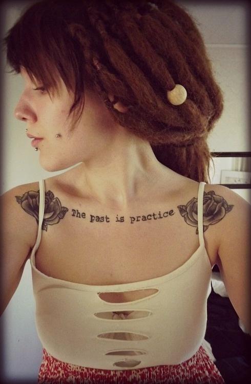 Chest text female tattoo