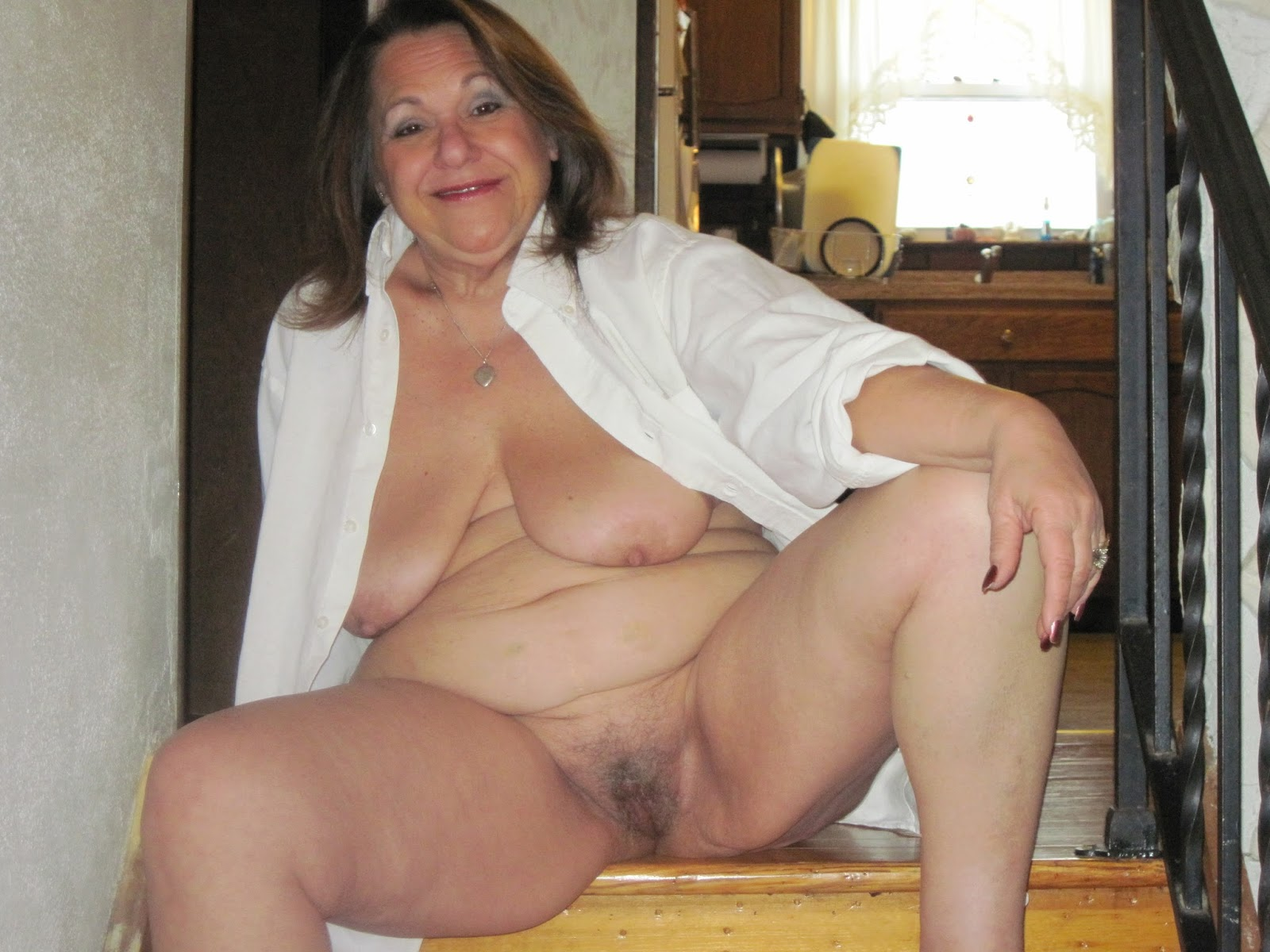 Mature women with spread naked legs