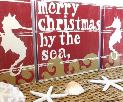 Christmas by the sea sign