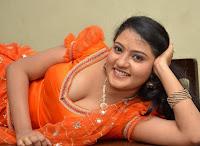 Akshayra South Indian Item Girl in Orange Deep Neck Salwar Spicy Smiling pics