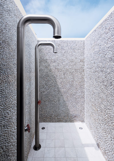 Pebble wall shower in the master bathroom