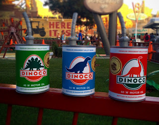 cars land oil cans