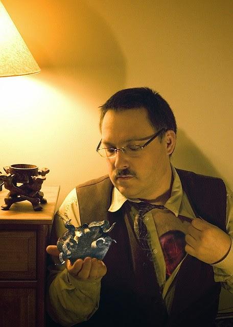 Man holding strange object