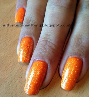 w7 orange glitter