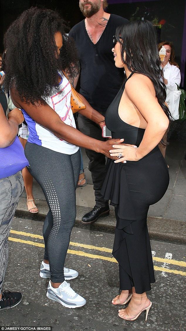 Kim Kardashian flaunts ample cleavage in a black dress in London