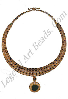 HASLI (rigid neck collar) North India IT century Private collection Mughal aesthetics ranged from excessive opulence to classical simplicity. This hash, set with white sapphires (pukhraj) is cleverly wrought with geometric repeats tapering towards the end in the form of the traditional rigid collar necklaces.