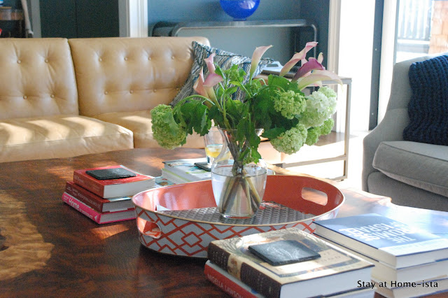a kid-friendly way to style a living room- stacks of books 