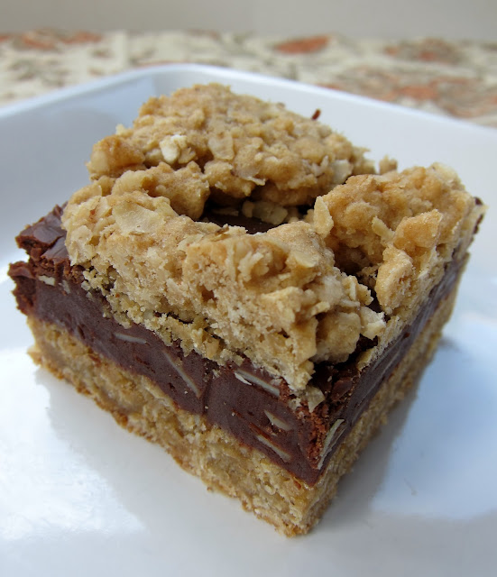 Oatmeal Fudge Bars - oatmeal almond cookie bars with a yummy fudge layer in the middle. Great make ahead dessert. Perfect potluck dessert.