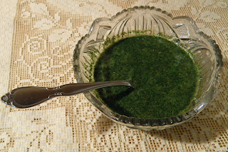 Bowl of Mint Sauce with Spoon