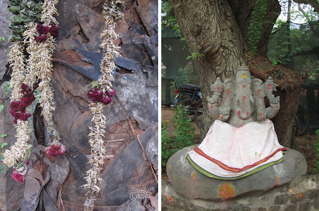 Ganesha with multiple heads and dried flowers