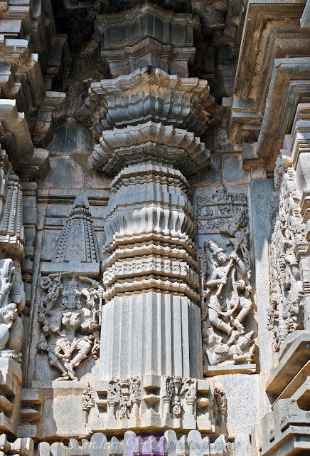 Huge columns on the walls of the temple