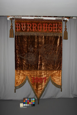 Restoration and repair of historic antique textiles, art conservation, 1887 banner and flag