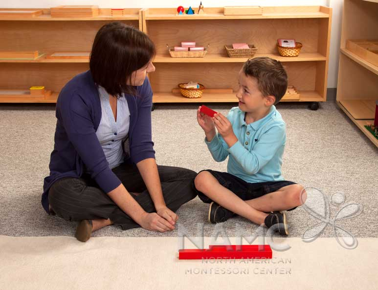 NAMC montessori following the child red rods at mat
