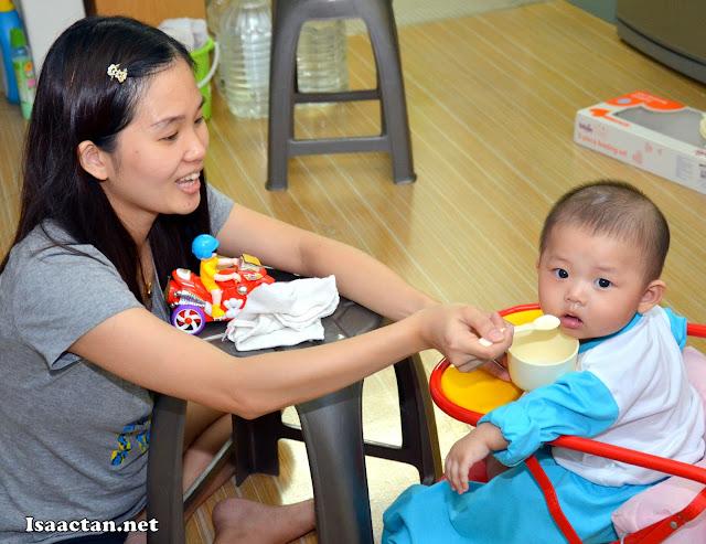 Janice feeding Baby Martin